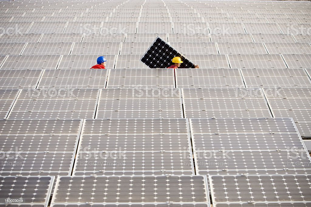 Carrying a Solar Panel royalty-free stock photo