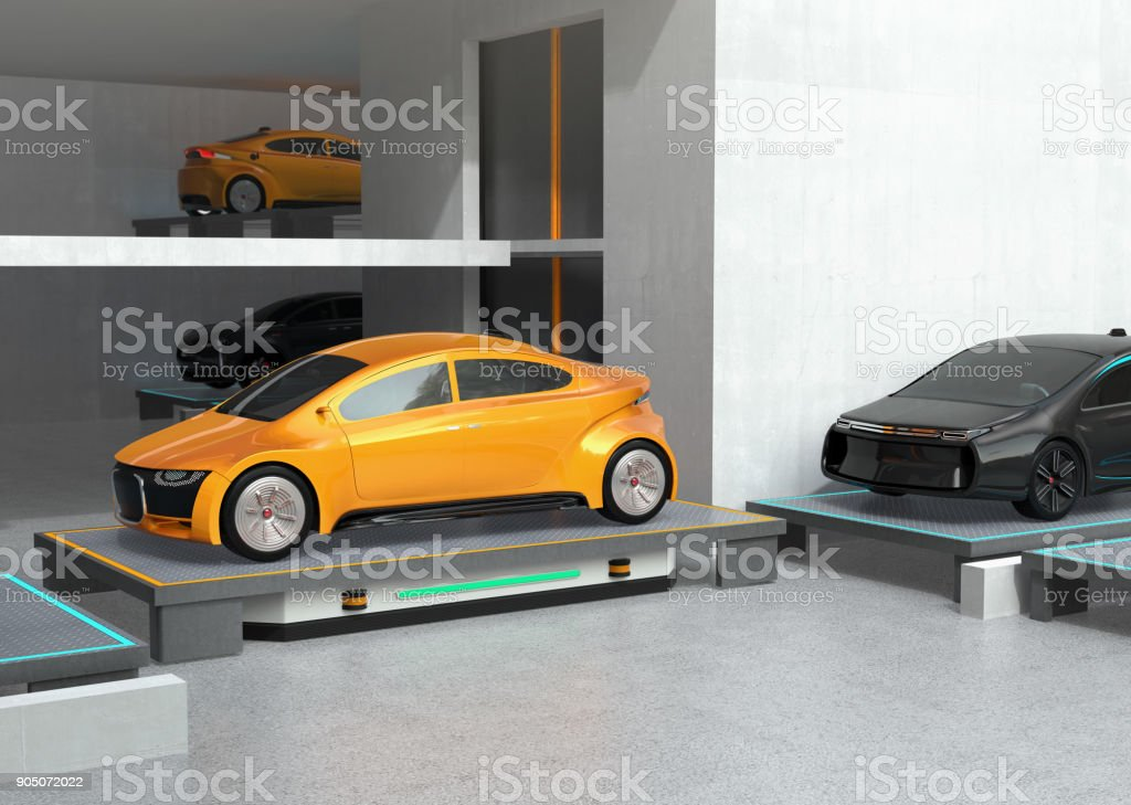 AGV carrying a yellow car to parking space stock photo