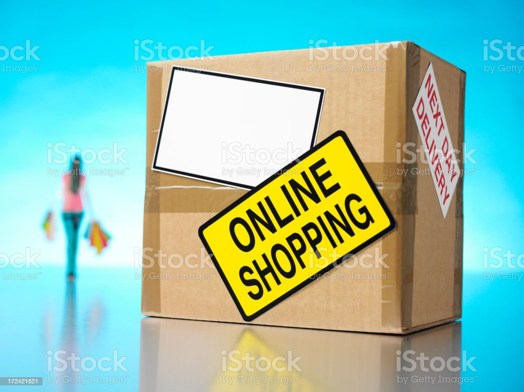 Carrying Bags with a Cardboard Box and Online Shopping royalty-free stock photo