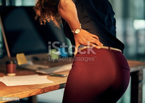 istock Carrying her stress in her back 628507154