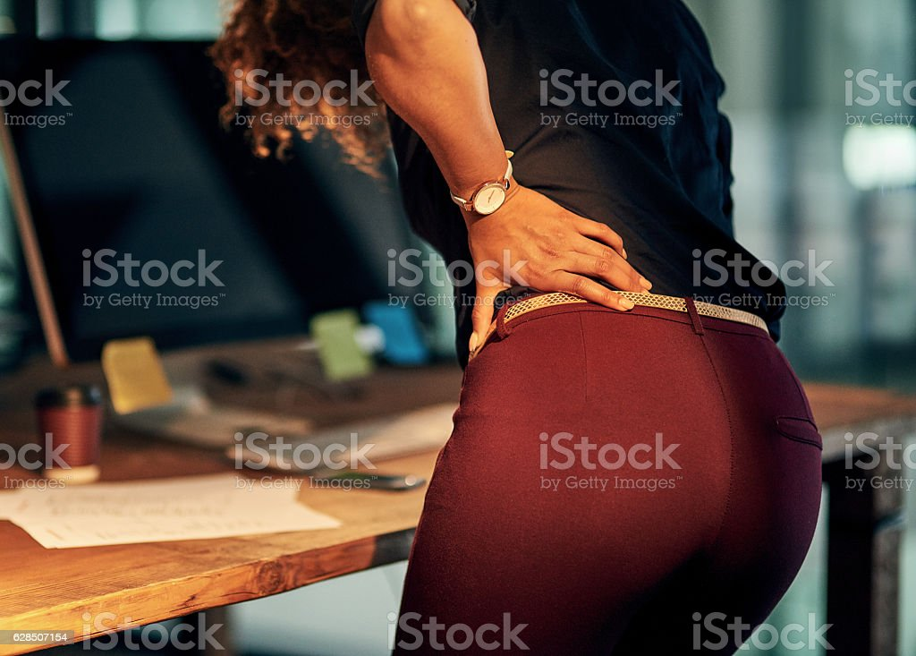 Carrying her stress in her back stock photo