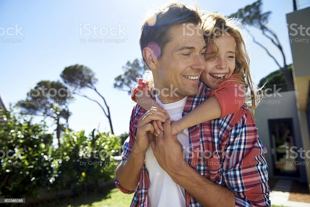 Carrying his little girl through life stock photo