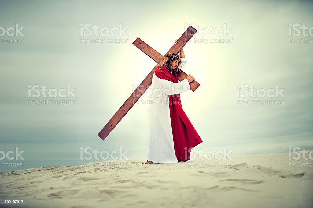 Carrying his own cross, he went out to Golgotha stock photo