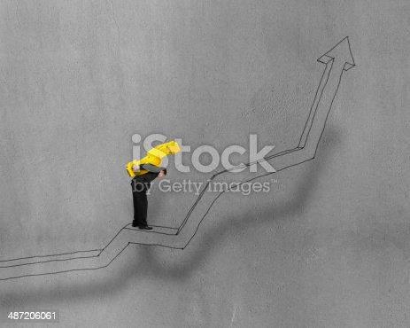 istock Carrying money symbol standing on growing arrow 487206061