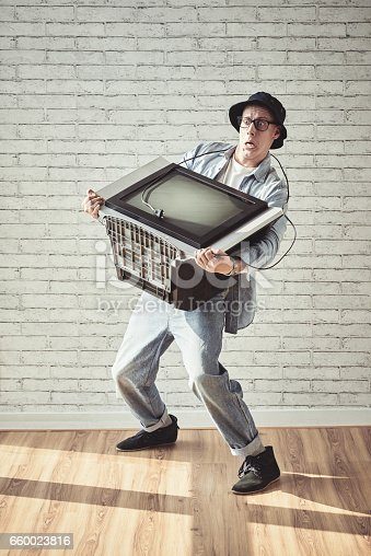 istock Carrying old tv 660023816