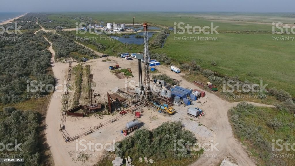 Carrying out repair of an oil well stock photo