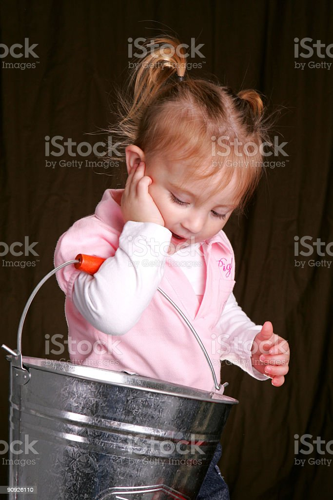 Carrying the pail stock photo