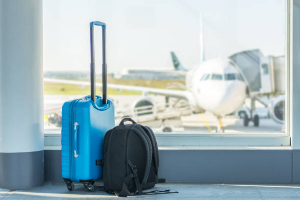 Carry-on in front of a plane Traveling far away travel stock pictures, royalty-free photos & images