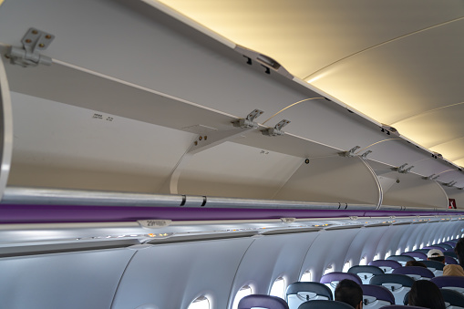 Carryon Luggage In Overhead Storage Compartment On