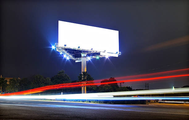 Cars and billboards Cars and billboards electronic billboard stock pictures, royalty-free photos & images