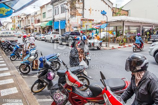 istock Cars and motorbikes parked on Thalang Road. 1159553914