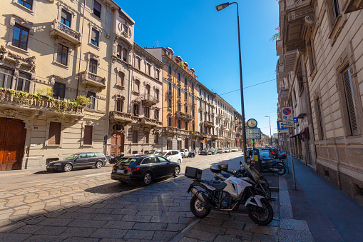 Cars and motorcycles parked on the street Via Luigi Settembrini
