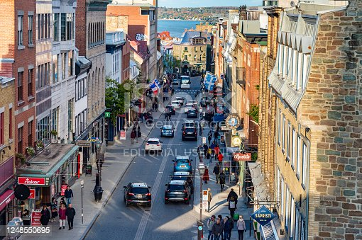 Quebec City, Canada - 4 October 2019: Cars and pedestrians on Saint Jean street in Old Quebec.