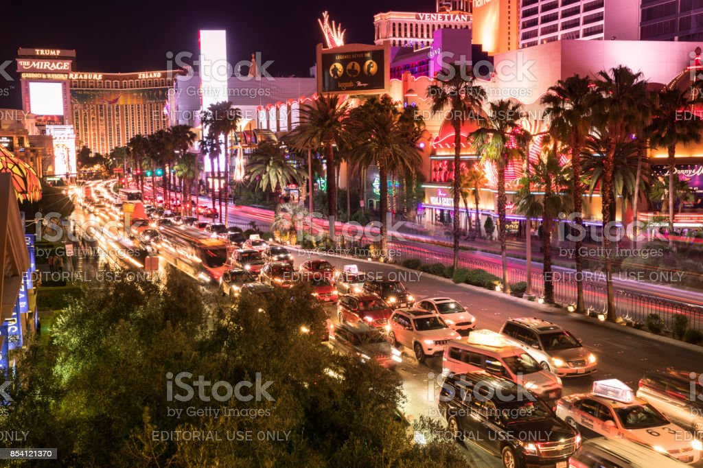 Cars And People By The Paris Hotel On Famous Las Vegas Strip At Night Royalty