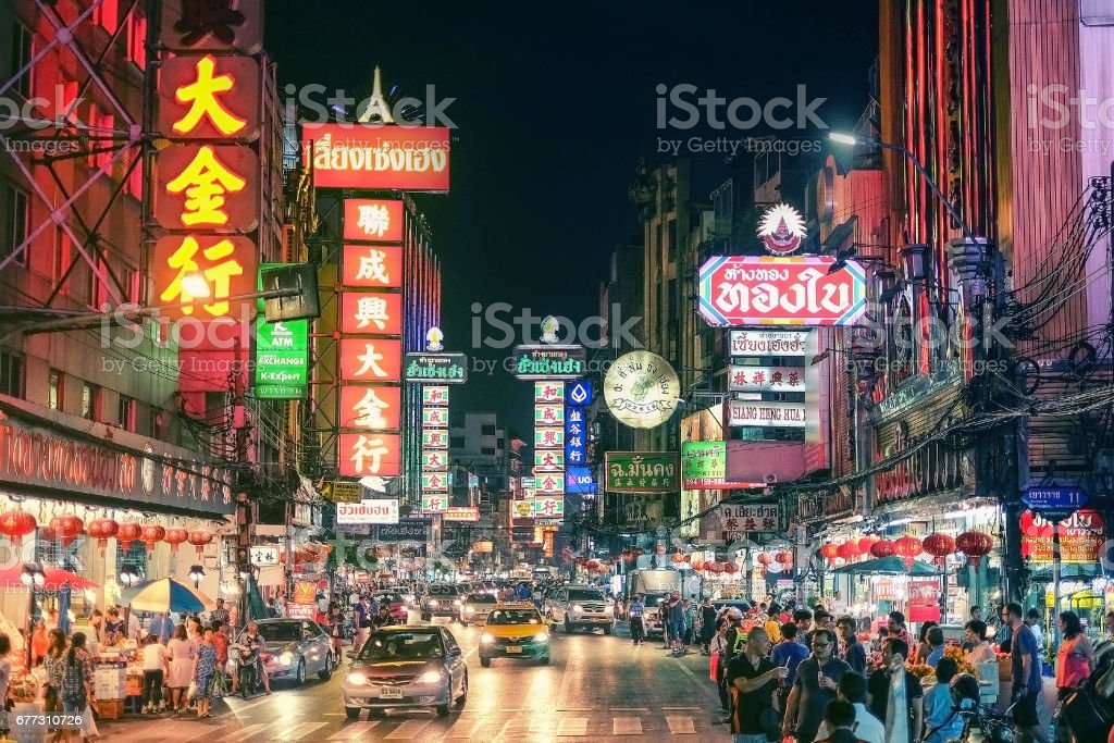 CHINATOWN, BANGKOK, THAILAND - 9 JANUARY, 2016: Cars and shops on Yaowarat road, the main street of China town. stock photo