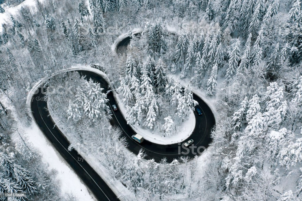 Cars and trucks on road in the middle of the winter stock photo