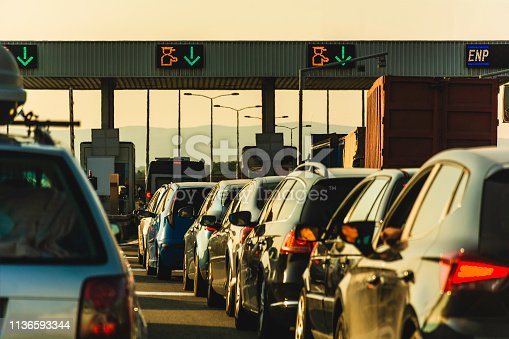 Cars waiting at highway pay toll peage