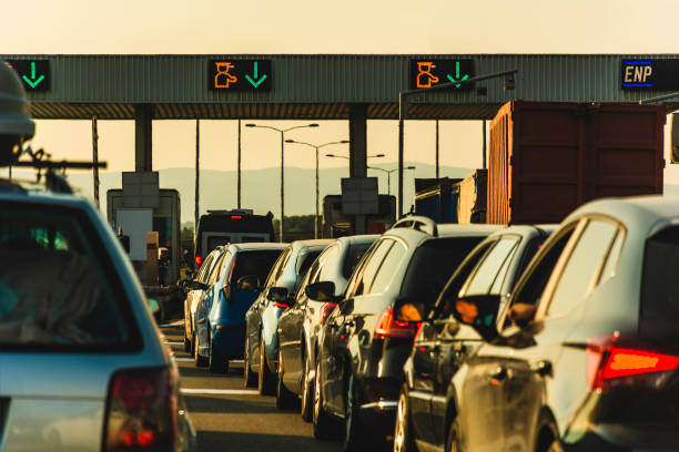 Cars and trucks waiting at point of toll highway - Toll station check point traffic jam - Highway toll peage Cars waiting at highway pay toll peage serbia stock pictures, royalty-free photos & images
