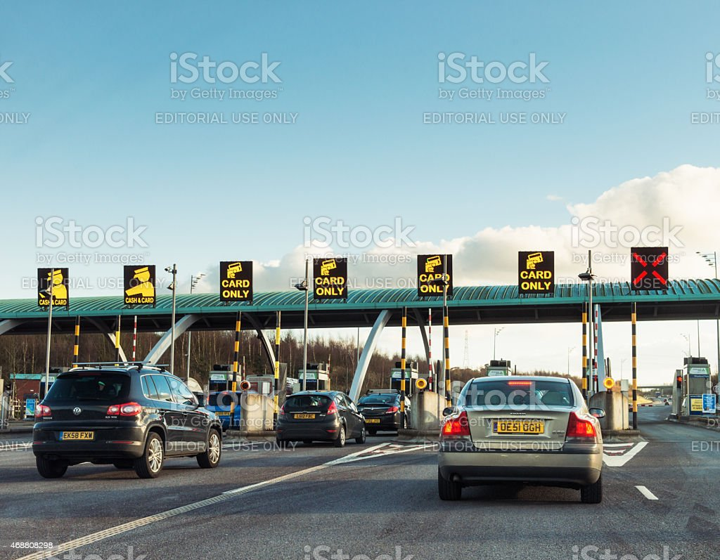 Cars approaching road toll gates stock photo