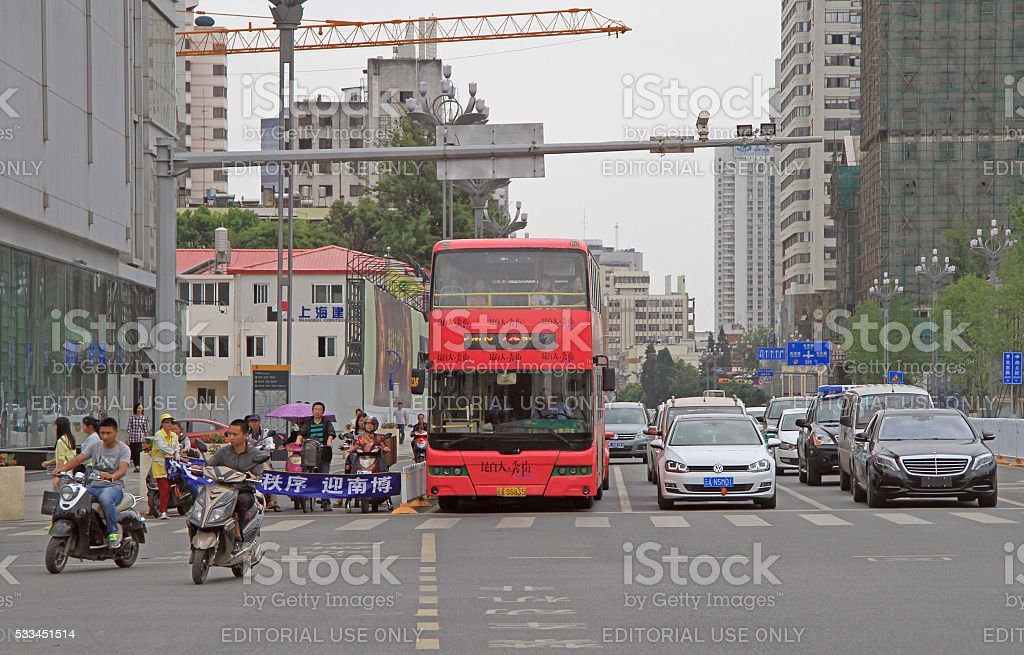 cars are waiting for the green signal of traffic light in Kunming,...