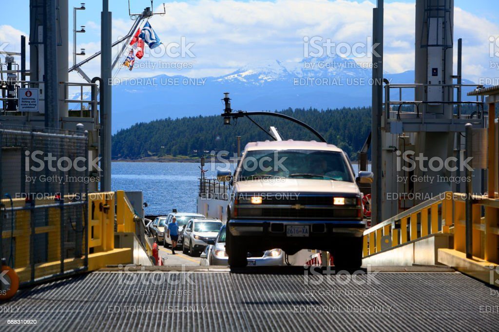 Cars Ascending From The BC Ferry Onto Hornby Island stock photo