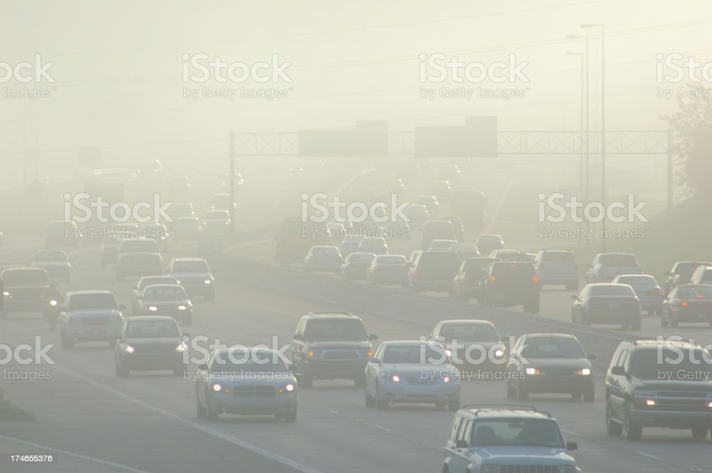 Cars at Rush Hour Driving Through Thick Smog stock photo