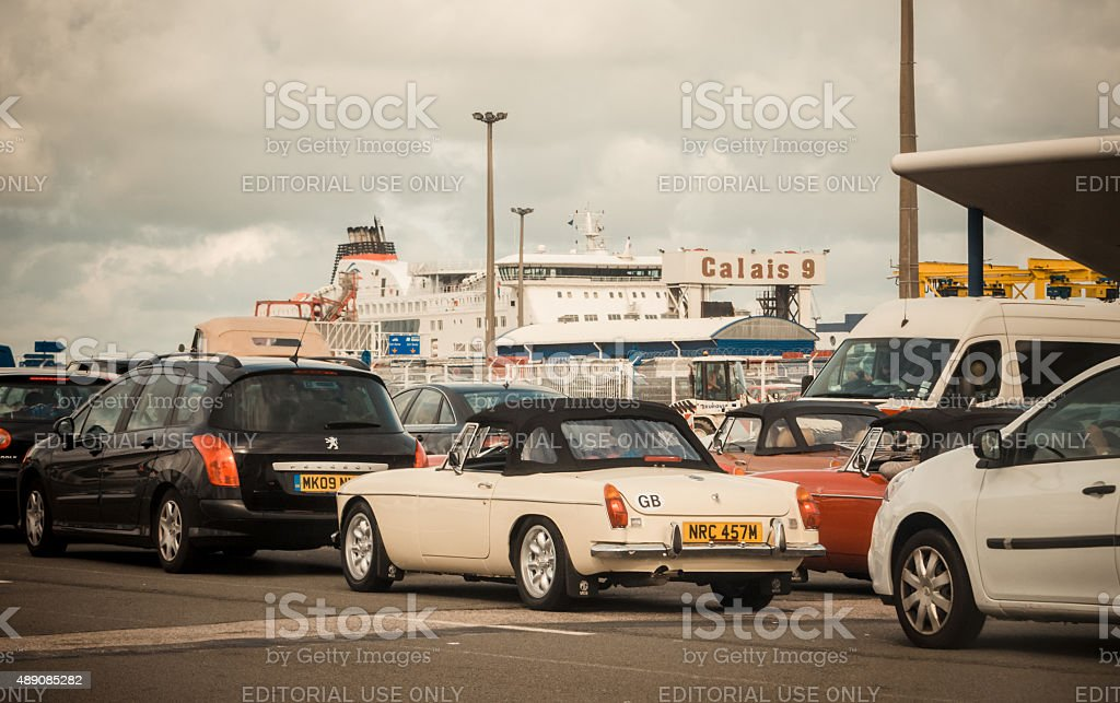 Cars boarding the ferry at Calais stock photo
