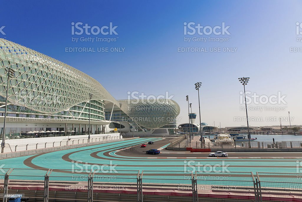 Cars cruising Yas Marina Circuit stock photo