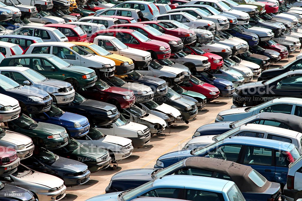 cars destroyed in the courtyard of the automobile junkyard stock photo