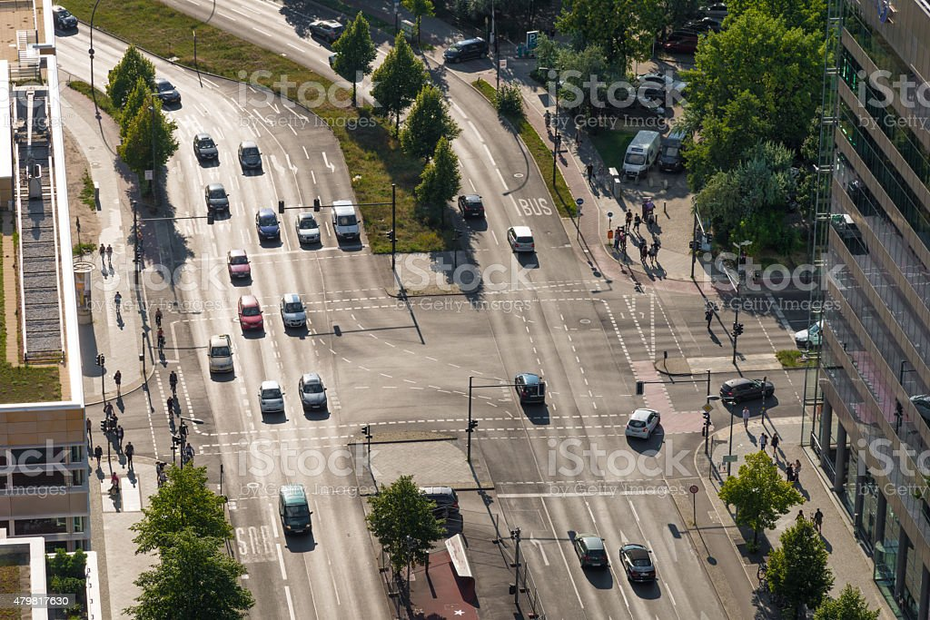 cars driving at crossroads. multi lane traffic in Berlin stock photo