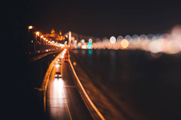 cars driving at night in the city along the river in Budapest stock photo