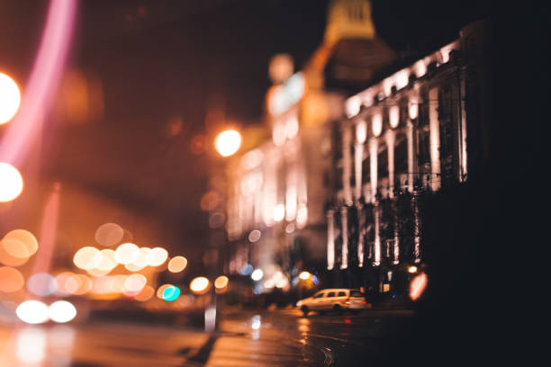 cars driving at night in the city, rain in the city stock photo