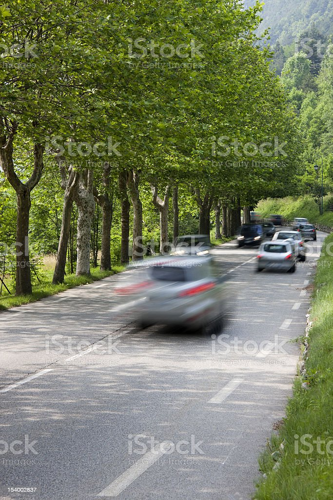Cars driving down country road royalty-free stock photo