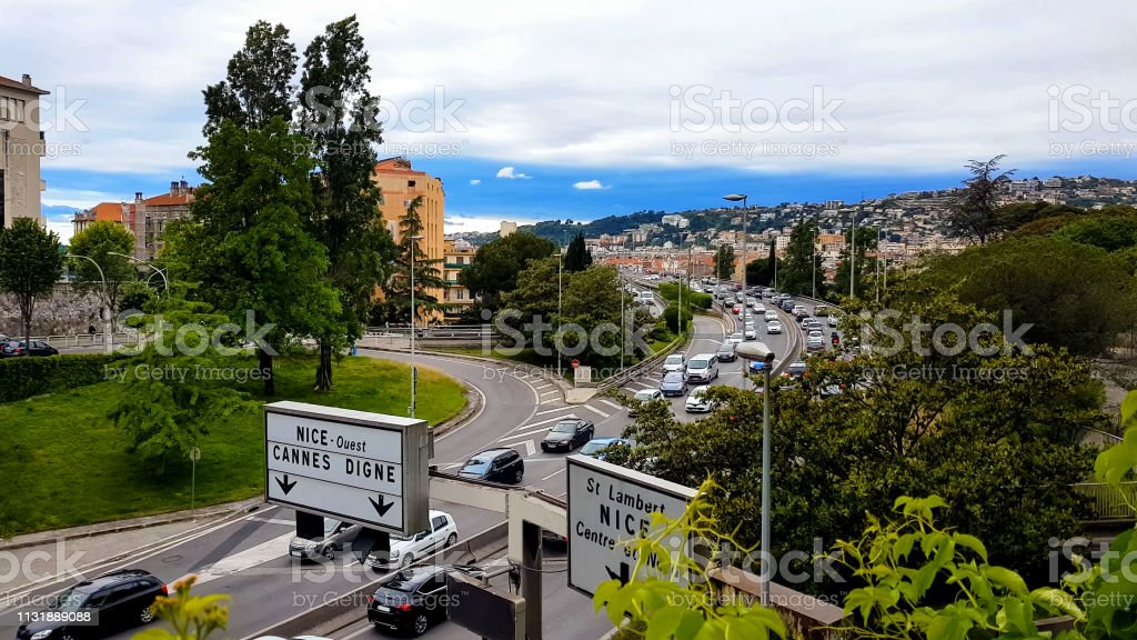 Cars driving on Nice road, city traffic France, ecology problem, air...
