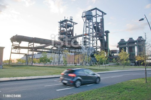 Cars driving past Hochofenplatz - a decommissioned steel factory in Phoenix West, Dortmund - Germany