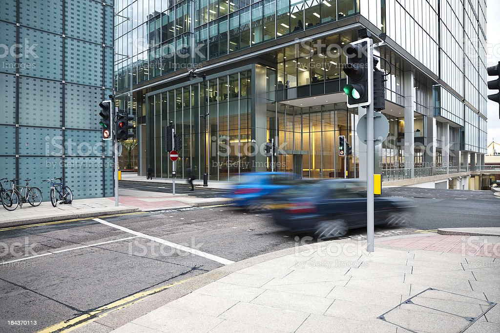 Cars Driving Through Canary Wharf Financial District of London, England stock photo
