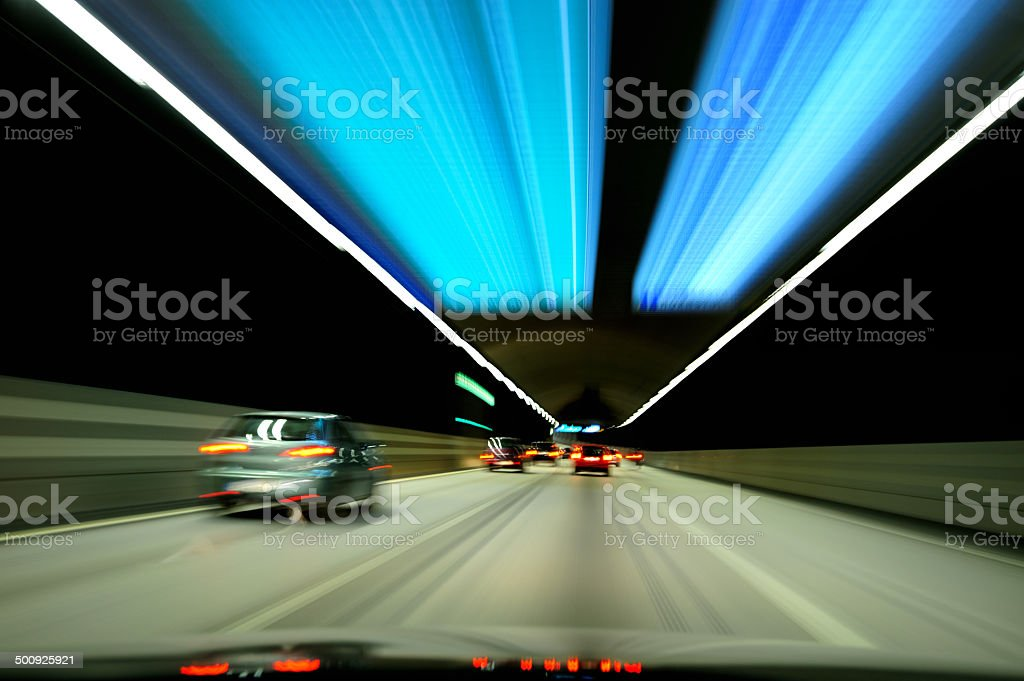 Cars driving through tunnel stock photo