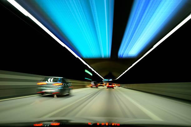 cars driving through tunnel - tunnel trafik sverige bildbanksfoton och bilder