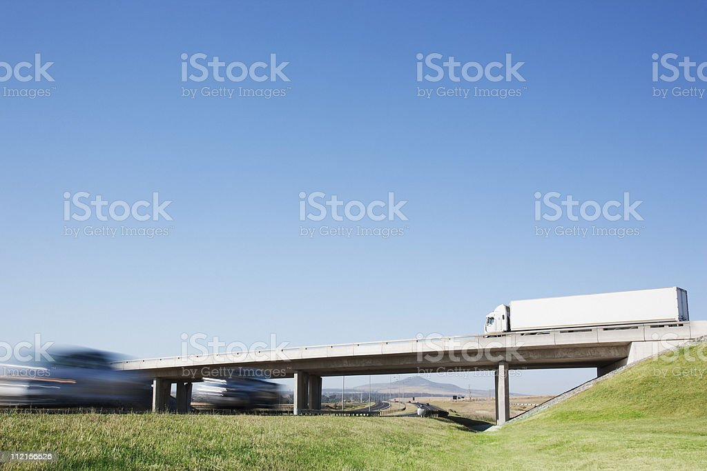 Cars driving under overpass royalty-free stock photo