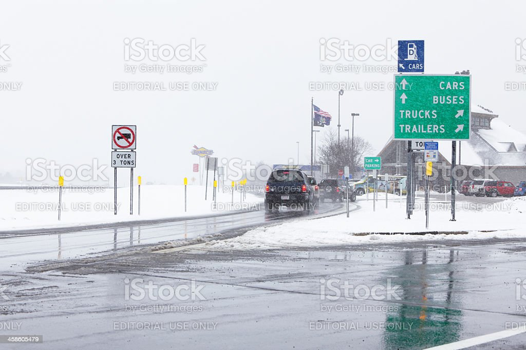 Cars Entering NY Thruway Rest Stop in Winter Blizzard stock photo