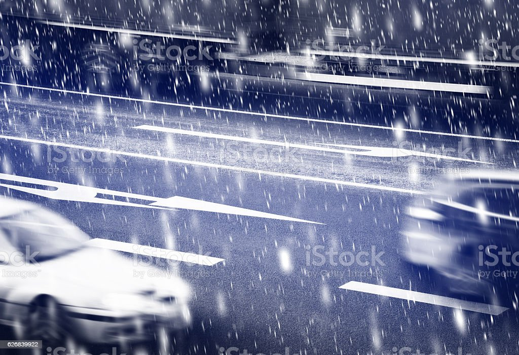 Cars going along the crossroads inthe winter stock photo