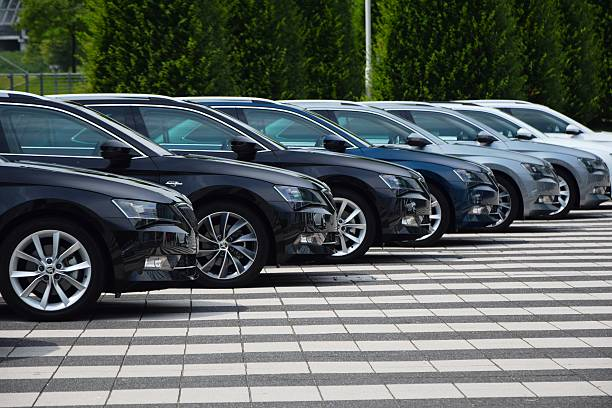 Cars in a row Munich, Germany - 3rd July, 2015: Skoda Superb cars stopped on the parking during the press launch. The first generation of Superb was debut in 2001 on the market. The third generation of luxury liftback from Skoda is powered by diesel or petrol engines (pushing out 110-280 HP). The Superb is the most luxury car in Skoda offer. vehicle brand name stock pictures, royalty-free photos & images