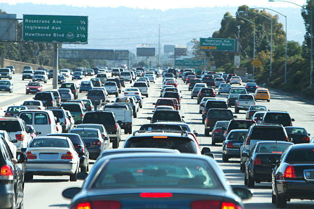 Cars in a traffic jam in Los Angeles, California A traffic jam on the 405 freeway in LA California. traffic jam stock pictures, royalty-free photos & images