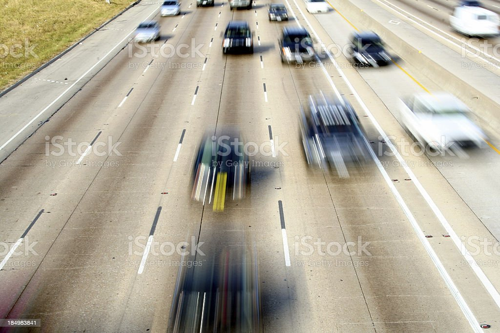Cars in motion driving down a freeway royalty-free stock photo