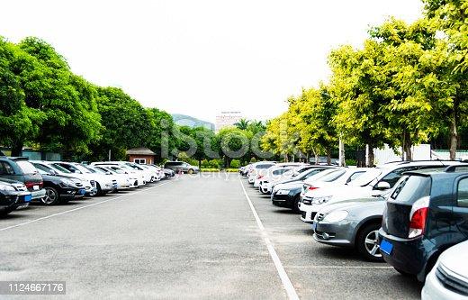 Cars in parking garage background.