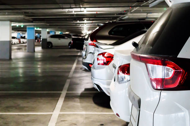 cars in parking garage interior stock photo