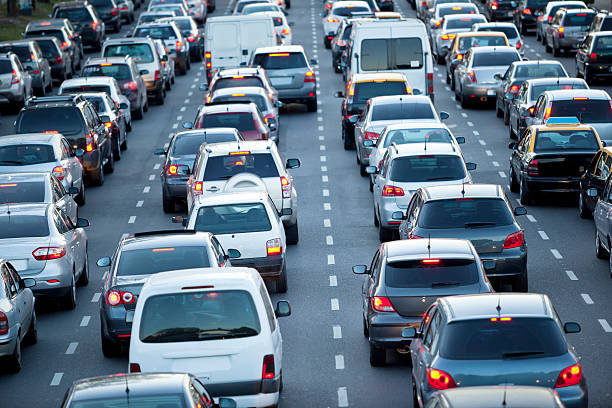 Cars in rush hour with traffic at dawn http://www1.istockphoto.com/generic_image_view/26784/26784 multiple lane highway stock pictures, royalty-free photos & images