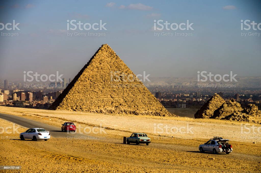 Cars in the Pyramids of Giza. Cairo, Egypt. stock photo