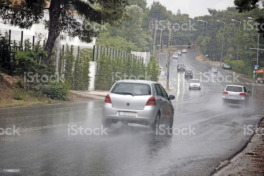 Cars in the rain royalty-free stock photo