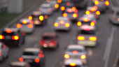 Cars in traffic,out of focus.Urban traffic jams. transportation